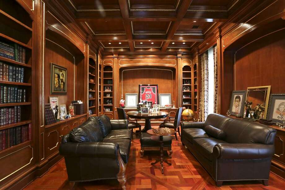 On the east side of the Rotunda is the Owner's very elaborate Retreat with seven facets. This Study has an intricate herringbone patterned wood floor and bookshelves galore. Behind one of the bookcases is a secret door that leads to..