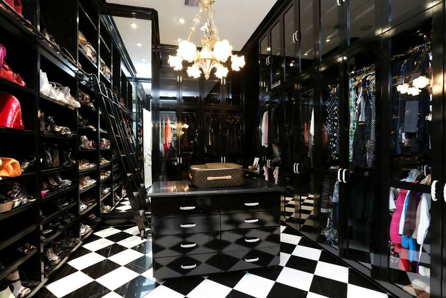Modeled after a Chanel boutique is one of the two closets. Outfitted with glass front cabinets, drawers, shoe nooks and a packing station, what an amazing place to decide what NOT to wear.