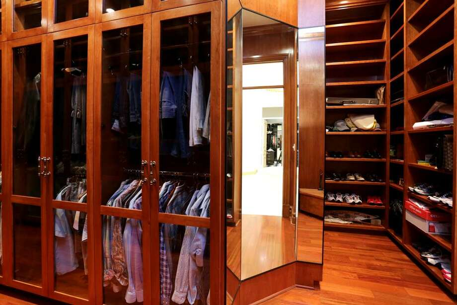 A second Master Closet has the glass front cabinets, shelves and shoe nooks, enough for the most avowed clothes horse.