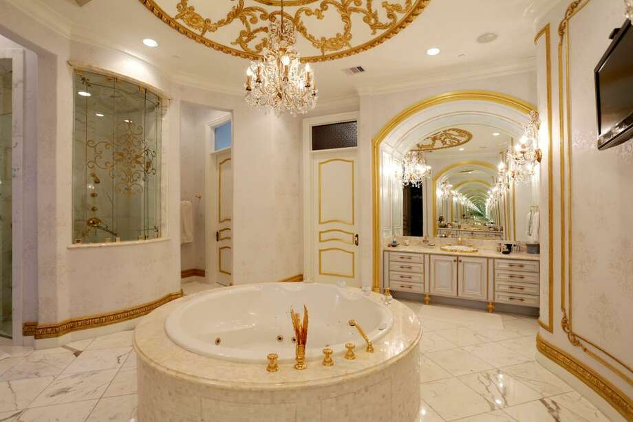 Fill the bathtub with bubbles and pop a bottle of bubbly in this peerless Master Bath. Dual water closets with bidets, dual vanities, a stall shower with panoramic view plus, in the center of it all is this Audrey Hepburn-worthy jetted tub.