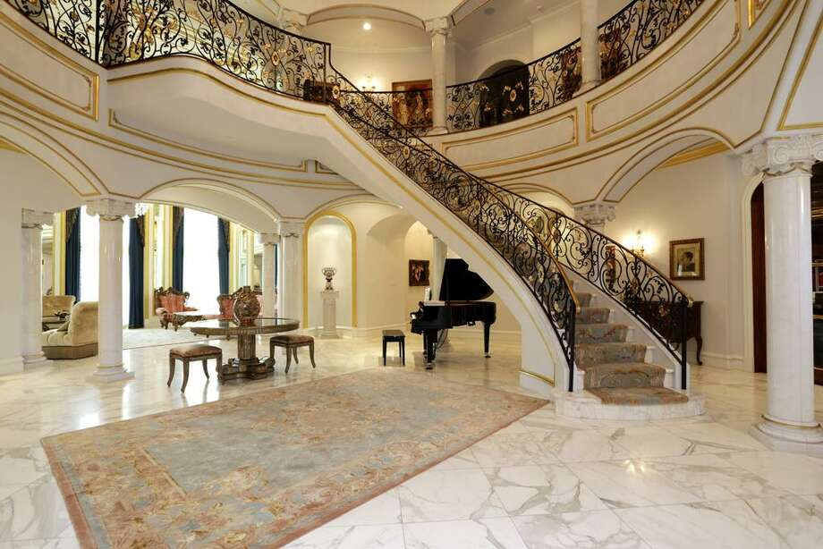 This marble swathed Rotunda--similar in size to the White House routunda--is the hub of this ingeniously designed home.