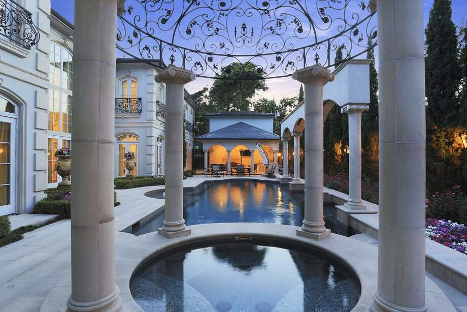 Accentuated by the repeating theme of arches and wrought iron this spa is crowned with an elegant cap.
