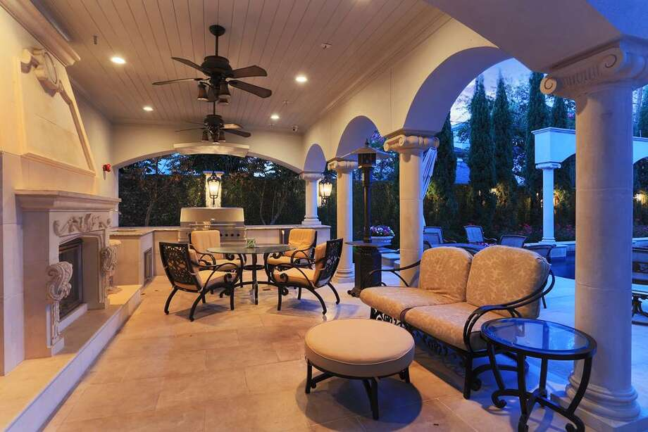 This covered outdoor LIving Space features a wood burning, gas assist fireplace, full Summer Kitchen, Mosquito Misting System and privacy galore. The home is also covered by a full house back-up generator.