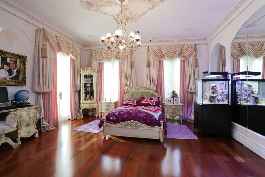 Scattered around the Second Floor are six, en-suite Secondary Bedrooms with extraordinarily accoutred closets. This bedroom is fit for a Princess.