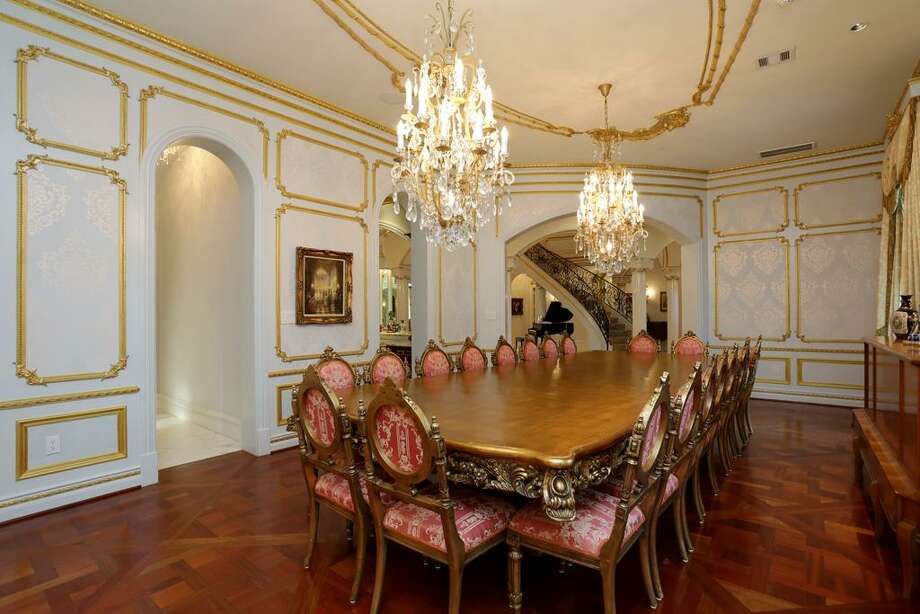 To the left off the Rotunda is this grand Formal Dining Room. Warm wood floors, and hand-wrought accents make this space tres elegant.