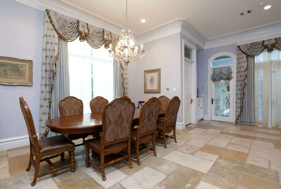 Open to the Formal Kitchen is this sunny Breakfast Room with an informal Powder Room.