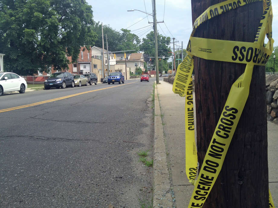 Crime scene tape left on a telephone pole looking north on Greenwich Avenue towards Richmond Hill Avenue after a man was shot twice in the area around 10 p.m. Tuesday, June 25, 2013. Photo: John Nickerson