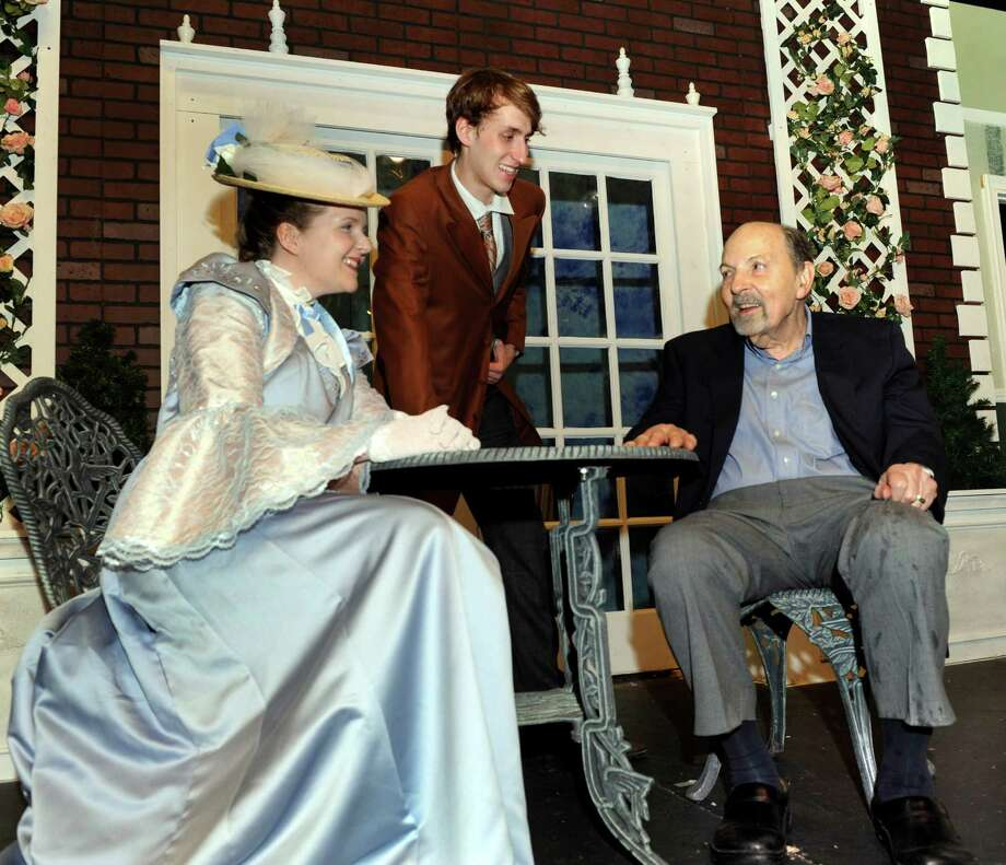 "Carey Van Hollen, 29, left, of Danbury and Ian Maitland, 20, of New Fairfield, chat with Leonard Diamond on the set of "" Earnest, or What's In a Name?""  Monday, June 24, 2013. Diamond wrote the book, music and lyrics of this musical adaptation of Oscar Wilde's ""The Importance of Being Earnest."" The play is being performed at TheatreWorks in New Milford, Conn. Photo: Carol Kaliff / The News-Times"