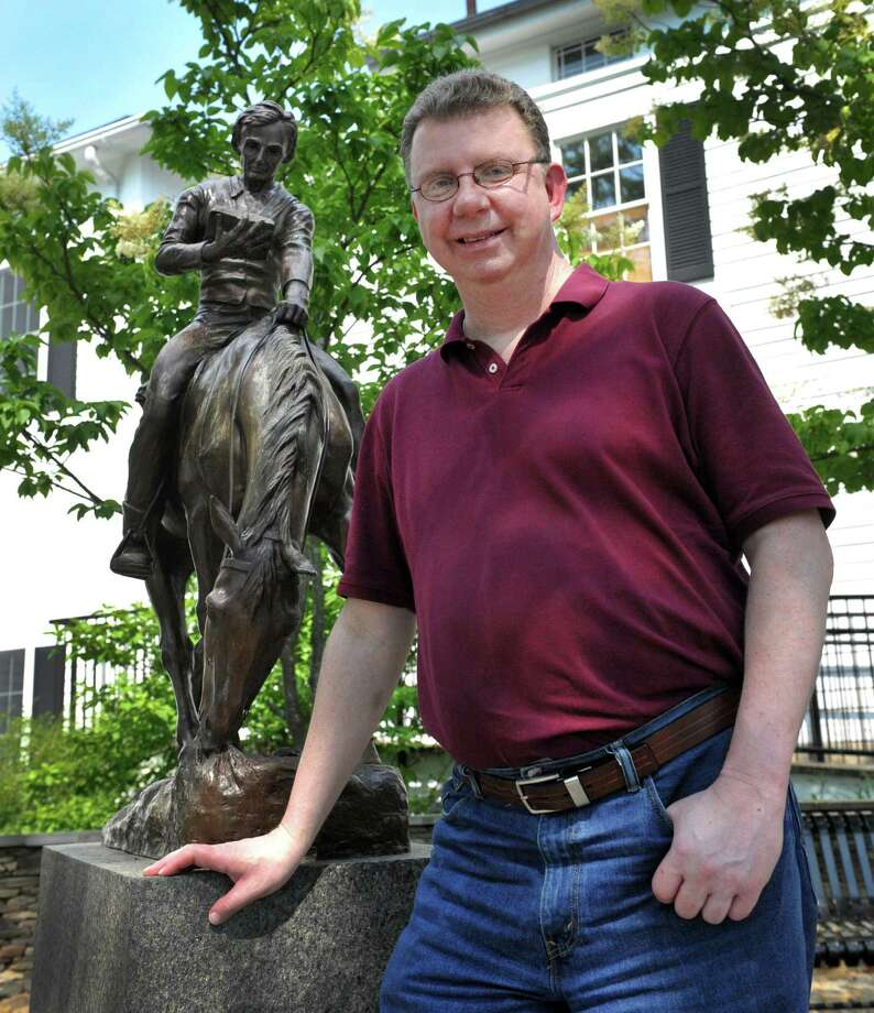 Thomas Craughwell, of Bethel, is photographed at the Bethel Library near a statue of Abraham Lincoln by Anna Huntington, in Bethel, Conn., Tuesday, June 25, 2013. Craughwell is the author of books about Lincoln and Thomas Jefferson. Photo: Carol Kaliff / The News-Times