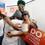 Brandon Benoit (center) hugs Martha Acevedo (L), 25, and Briana Castaneda, 23, as they celebrate the Supreme Court ruling at a watch party at Equality California, a non-profit civil rights organization that advocates for the rights of LGBT people in California, on June 26, 2013 in West Hollywood, California. The high court struck down the Defense of Marriage Act (DOMA) and ruled that supporters of California's ban on gay marriage, Proposition 8, could not defend it before the Supreme Court.