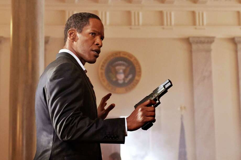 "Jamie Foxx stars as President James Sawyer in ""White House Down."" Though Foxx's president is slightly nerdy, he still can handle a rocket launcher. Photo: Reiner Bajo / © 2013 Columbia Pictures Industries, Inc.  All Rights Reserved. **ALL IMAGES ARE PROPERTY OF SONY PICTURES ENTERTAINMENT INC. F"