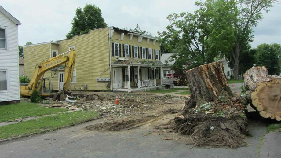 A house in Rensselaer was demolished after stiff wind gusts during Monday's storms toppled a massive maple tree, wrecking half of the two-story structure on Sixth Avenue. All that remained of 1710 Sixth St. on Wednesday, June 26, was the trunk of the tree.  (Bob Gardinier/Times Union)