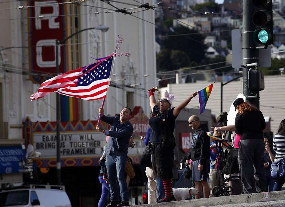 Enrique Chavez, left and Safiya Delaney cheers at the corner of Castro and Market, Wednesday June 26, 2013, as she and others celebrate the United States Supreme Court ruling on Section 3 of the federal Defense of Marriage Act that it is unconstitutional and that California's Proposition 8 has been struck down, Wednesday June 26, 2013, in San Francisco, Calif. Photo: Lacy Atkins, The Chronicle