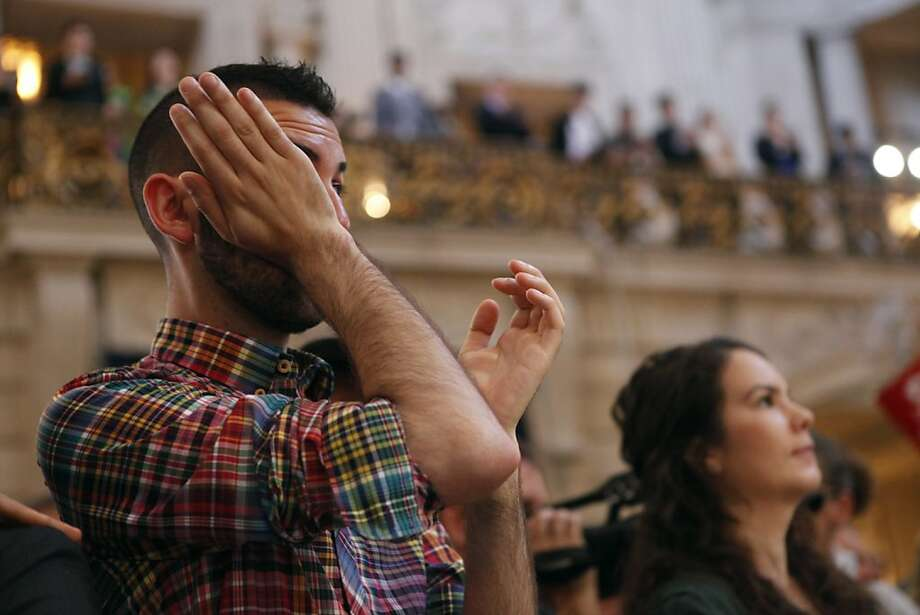 Jesse Castaneda reacts to the news about the DOMA ruling in City Hall, Wednesday June 26, 2013 in San Francisco, Calif. Photo: Katie Meek, The Chronicle