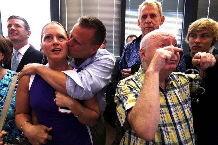 Gay marriage supporters celebrate at Katine & Nechman after the Supreme Court struck down the Defense of Marriage Act, Wednesday, June 26, 2013. (Johnny Hanson / Houston Chronicle)
