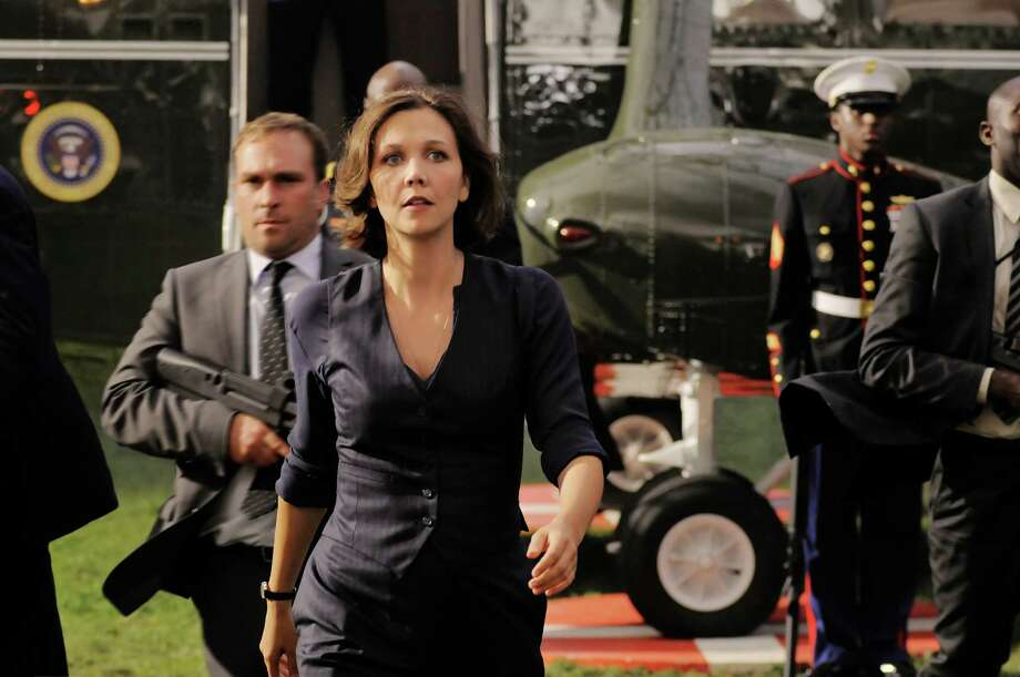 "This film publicity image released by Columbia Pictures shows Maggie Gyllenhaal in a scene from ""White House Down."" (AP Photo/Sony Columbia Pictures, Reiner Bajo) Photo: Reiner Bajo"