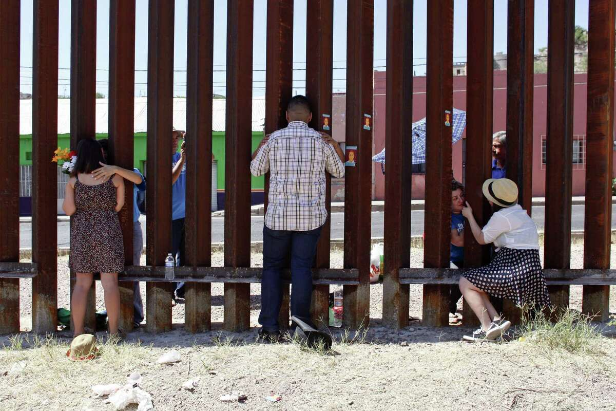 At a border fence in Arizona, three young immigrants are reunited with their parents, who were all deported. The parents traveled to the Mexican side of the fence from Brazil, Colombia and Guadalajara, Mexico, to see their children for the first time in many years.