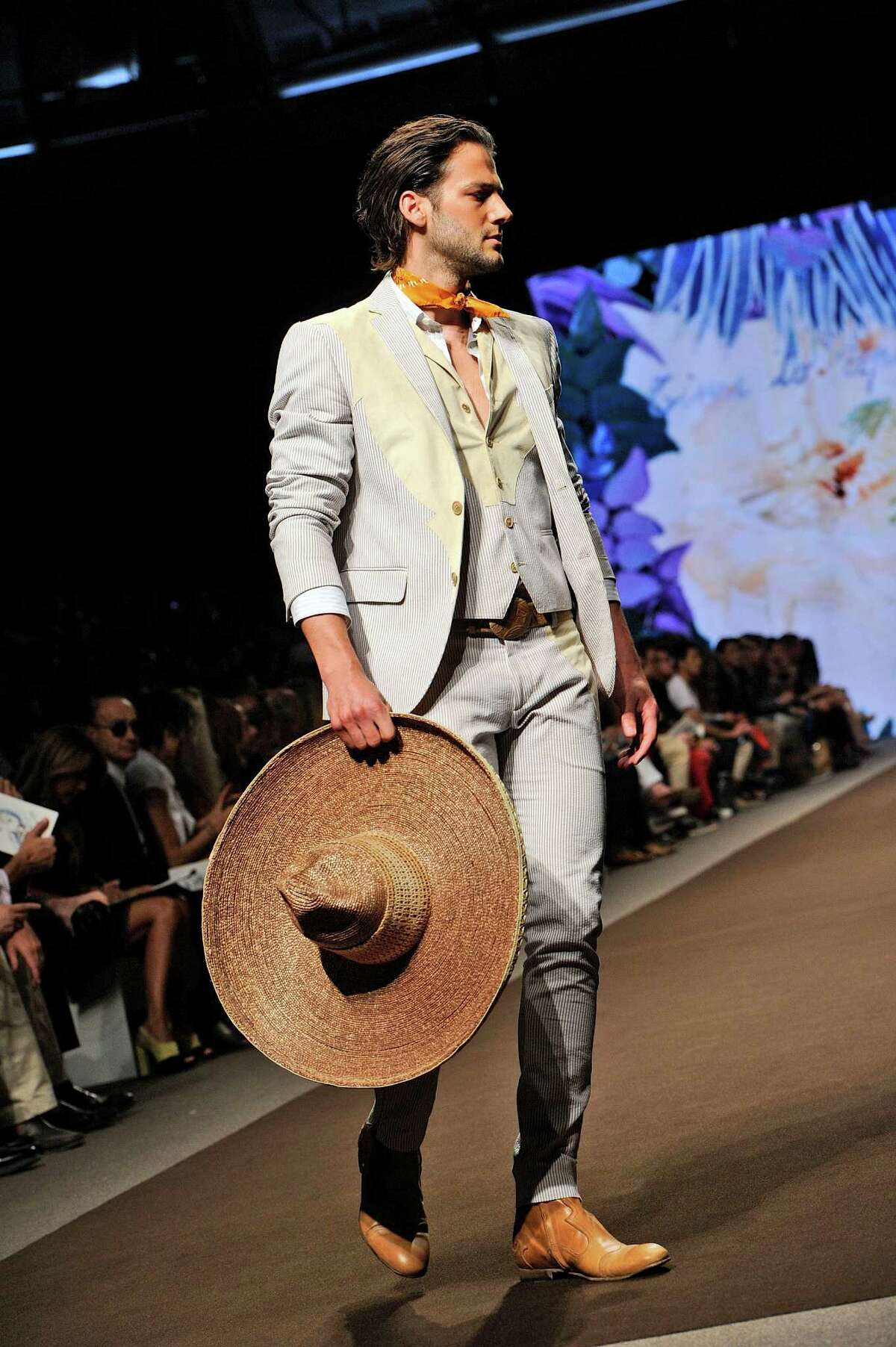 A model wears a creation for Etro men's Spring-Summer 2014 collection, part of the Milan Fashion Week, unveiled in Milan, Italy, Monday, June 24, 2013. (AP Photo/Giuseppe Aresu)