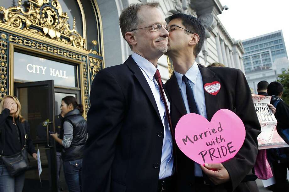 Longtime partners John Lewis and Stuart Gaffney, plaintiffs in a previous same-sex marriage case that reached the state Supreme Court, stand outside San Francisco's City Hall, where then-Mayor Gavin Newsom decided in 2004 to allow same-sex couples, including them, to wed. Photo: Michael Macor, The Chronicle