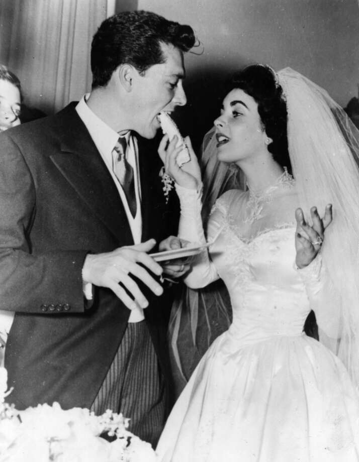 US film star Elizabeth Taylor and her first husband Nick Hilton, of the hotelier family, on their wedding day.   (Photo by Keystone/Getty Images)