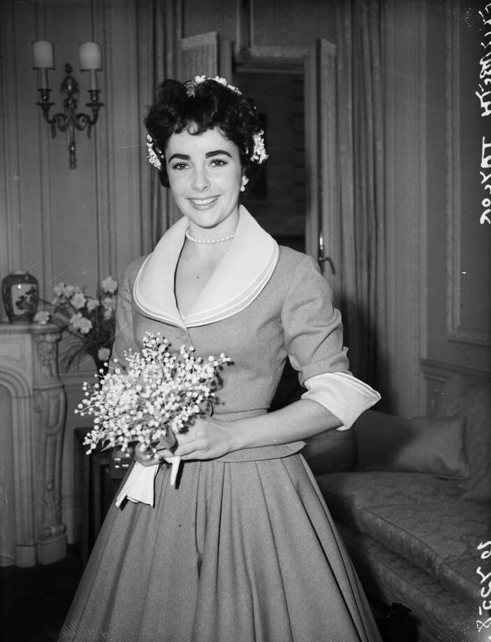 21st February 1952:  British-born actress Elizabeth Taylor on the day of her wedding to Michael Wilding. It was the second marriage for Taylor: Wilding and Taylor had two sons together, Michael Jr. and Christopher. The marriage lasted until 1957. (Photo by Fred Mott/Evening Standard/Getty Images)