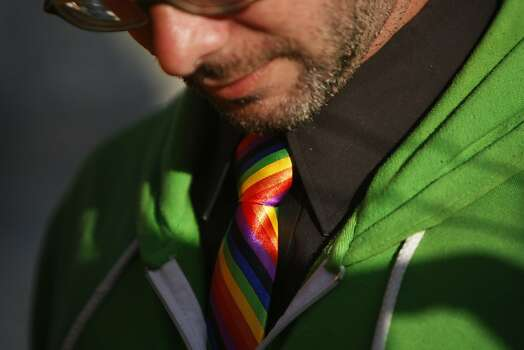 Gary McCoy wears a rainbow tie while waiting to hear the Supreme Court decision on DOMA/Prop 8 at the intersection of Market and Castro streets on June 27, 2013 in San Francisco, Calif. Photo: Pete Kiehart, The Chronicle