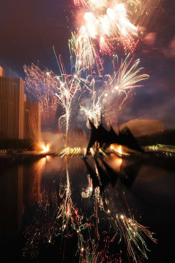 Fireworks light up the sky above Empire State Plaza in Albany, N.Y., Monday July 4, 2011, during Price Chopper's Homegrown 4th and Fireworks Festival show. (Will Waldron /Times Union)