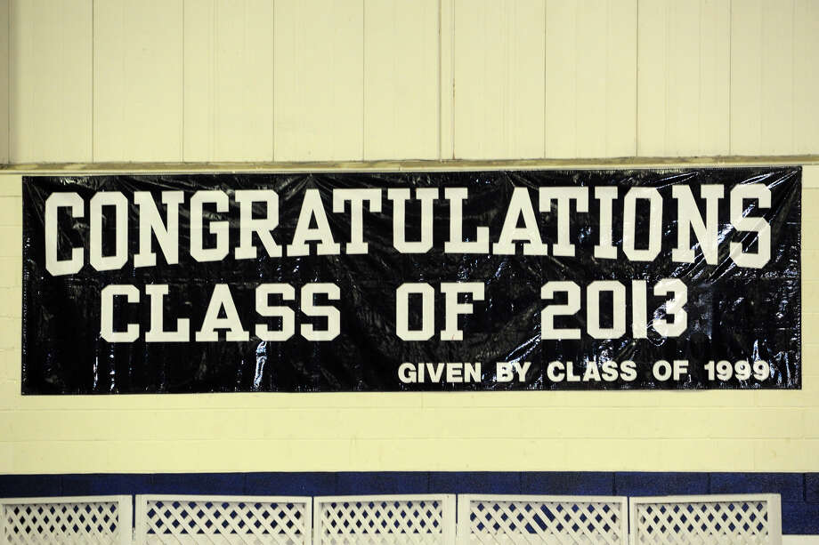A sign at Staples High School graduation acknowledged success. Now, another chapter opens for the Class of 2013. Photo: Ned Gerard / Connecticut Post