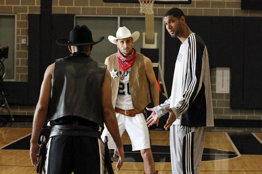 Spurs' Tony Parker (with back to camera), Manu Ginobili and Tim Duncan film a commerical for HEB Monday Oct. 4, 2010 at the Spurs practice facility. (PHOTO BY EDWARD A. ORNELAS/eaornelas@express-news.net) Photo: EDWARD A. ORNELAS, SAN ANTONIO EXPRESS-NEWS / eaornelas@express-news.net
