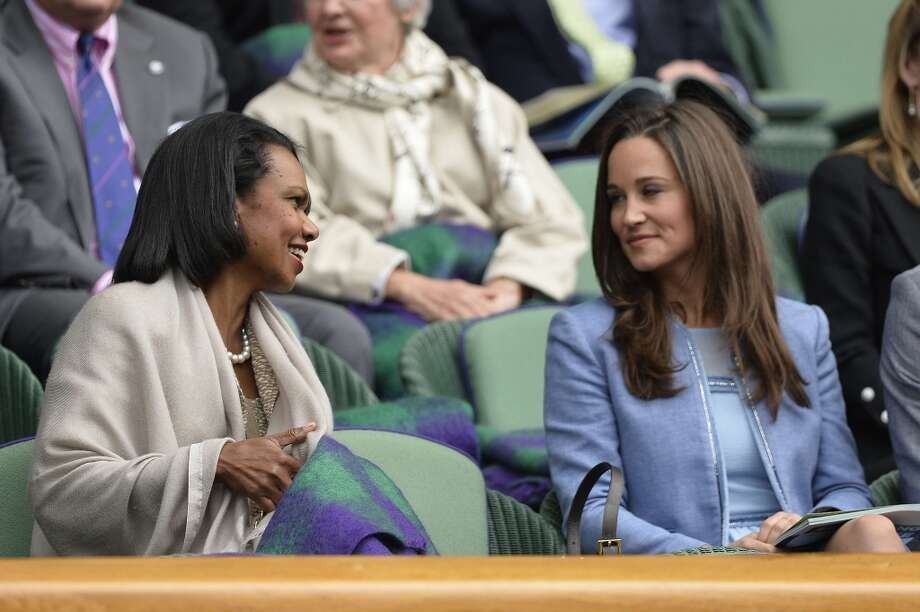 Former US secretary of state Condoleezza Rice talks with Pippa Middleton, sister of Catherine Middleton, Duchess of Cambridge, in the box at centre court.