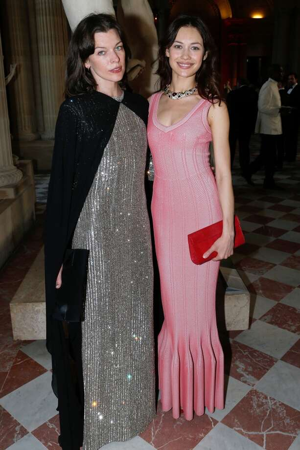 Actresses Milla Jovovich, left, and Olga Kurylenko