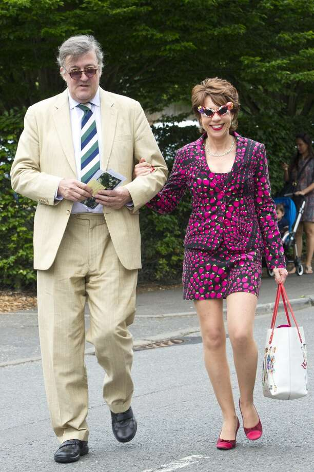Stephen Fry and Kathy Lette sighted at Wimbledon in June 26, 2013 in London, England.