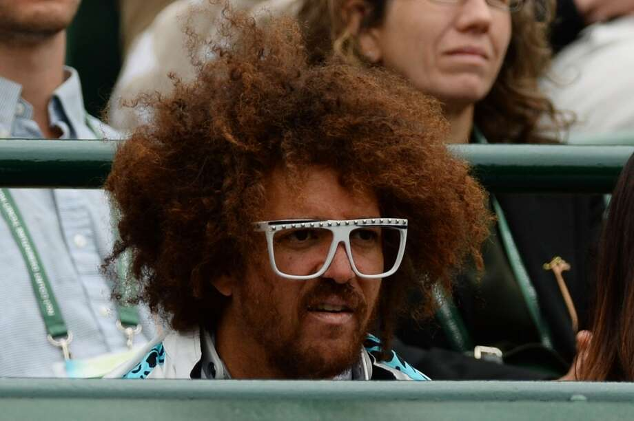 Stefan 'Redfoo' Gordy watches the Ladies' Singles first round match between Victoria Azarenka of Belarus and Maria Joao Koehler of Portugal on day one of the Wimbledon Lawn Tennis Championships at the All England Lawn Tennis and Croquet Club on June 24, 2013 in London, England.