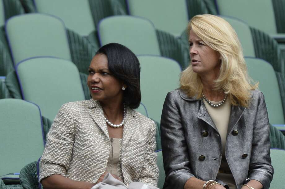 Former US secretary of state Condoleezza Rice watches Switzerland's Roger Federer take on Romania's Victor Hanescu in their first round match on day one of the 2013 Wimbledon Championships tennis tournament at the All England Club in Wimbledon, southwest London, on June 24, 2013.
