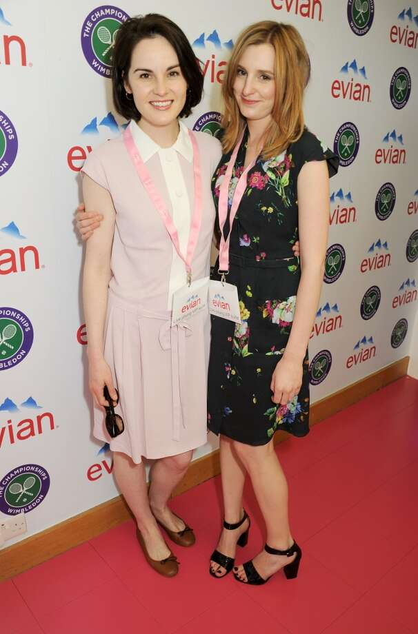 Michelle Dockery (L) and Laura Carmichael attend the evian 'Live Young' Suite at Wimbledon on June 24, 2013 in London, England.  (Photo by Dave M. Benett/Getty Images for evian)