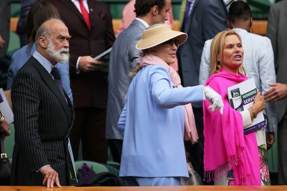 Prince Michael of Kent (L) and Princess Michael of Kent (C) leave their seats in the royal box on day one of the Wimbledon Lawn Tennis Championships at the All England Lawn Tennis and Croquet Club on June 24, 2013 in London, England.