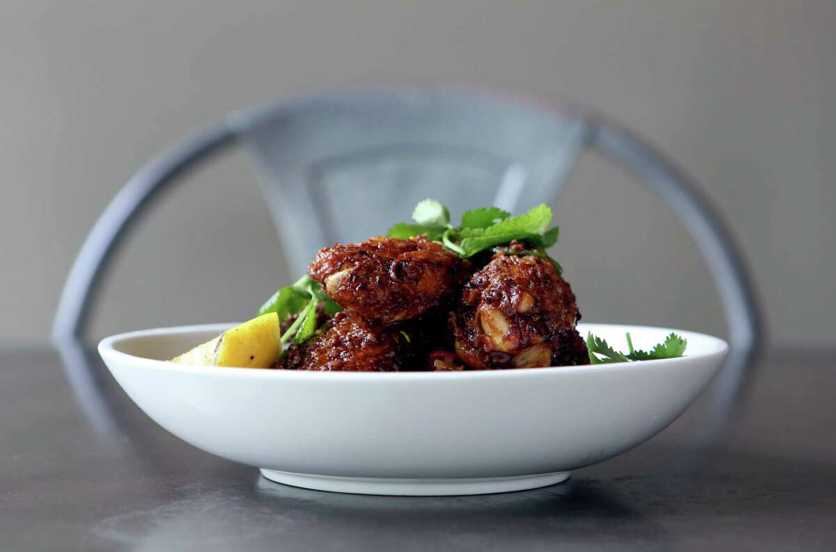 Chef Jesse Perez's wings flash fried with a lemon-berry-chile sauce are serves at Arcade Midtown Kitchen.