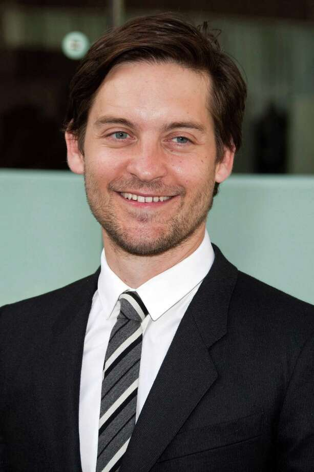 FILE - In this May 24, 2010 file photo, actor Tobey Maguire arrives to the Film Society of Lincoln Center's 37th Chaplin Award Gala honoring Michael Douglas in New York. Maguire has agreed to pay $80,000 to settle a lawsuit seeking repayment of more than $300,000 he won from a convicted con man during high stakes private poker games. (AP Photo/Charles Sykes, file) Photo: Charles Sykes / AP2010
