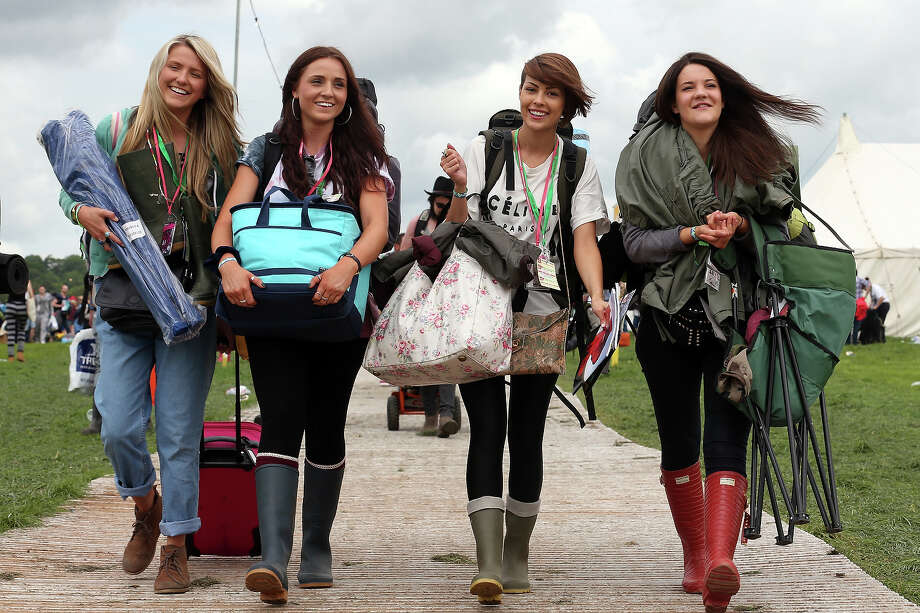 (L-R) Tash Sullivan, Jessica Shakles, Zoe Audibert and Rose Long arrive at the Glastonbury Festival of Contemporary Performing Arts site at Worthy Farm, in Pilton at Worthy Farm, Pilton on June 26, 2013 near Glastonbury, England.  Gates opened today at the Somerset diary farm that will be playing host to one of the largest music festivals in the world and this year features headline acts Arctic Monkeys, Mumford and Sons and the Rolling Stones. Tickets to the event which is now in its 43rd year sold out in minutes and that was before any of the headline acts had been confirmed. The festival, which started in 1970 when several hundred hippies paid 1 GBP to watch Marc Bolan, now attracts more than 175,000 people over five days. Photo: Matt Cardy, Getty Images / 2013 Getty Images