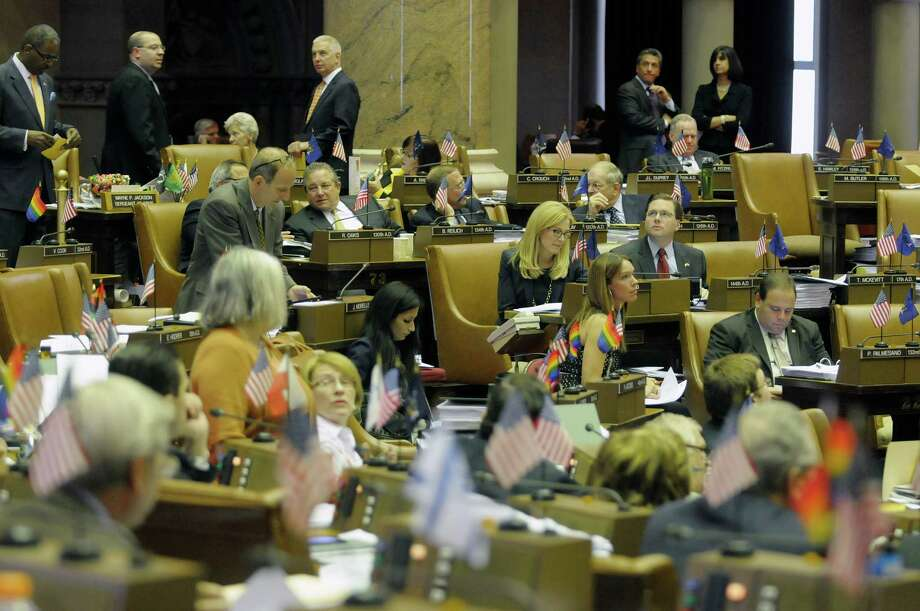 Members of the Assembly and their staff work  on the floor of the Assembly chambers at the capitol on Wednesday, June 19, 2013 in Albany, NY.  (Paul Buckowski / Times Union) Photo: Paul Buckowski