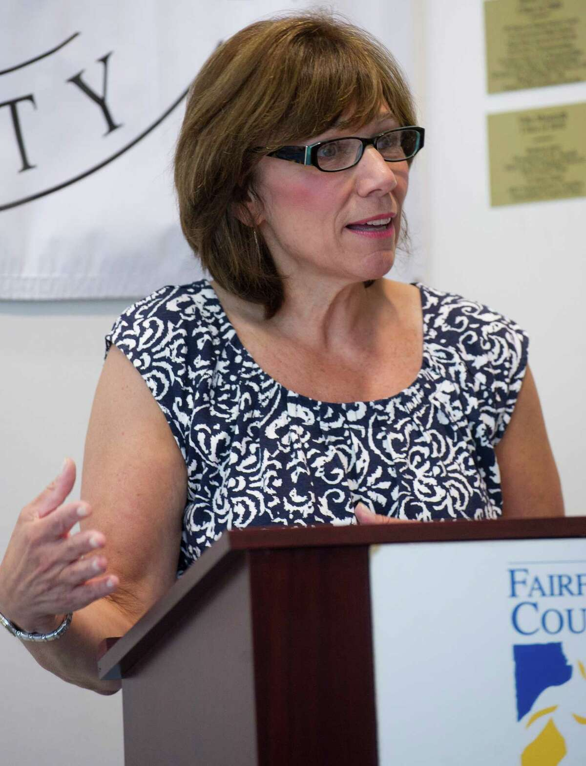 Cheryl Tiscia speaks during the Fairfield County Hall of Fame 2013 induction announcement after her sister, Allyson Rioux, was announced as an inductee into the James OâÄôRourke Amateur Wing at the University of Connecticut's Stamford campus on Wednesday, June 26, 2013.
