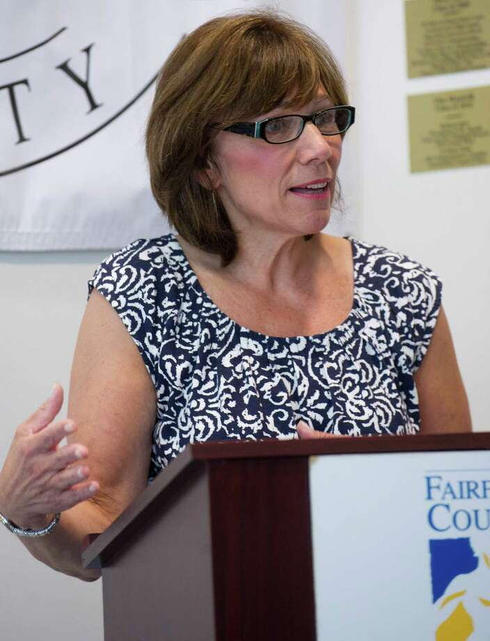 Cheryl Tiscia speaks during the Fairfield County Hall of Fame 2013 induction announcement after her sister, Allyson Rioux, was announced as an inductee into the James OâÄôRourke Amateur Wing at the University of Connecticut's Stamford campus on Wednesday, June 26, 2013. Photo: Lindsay Perry / Stamford Advocate
