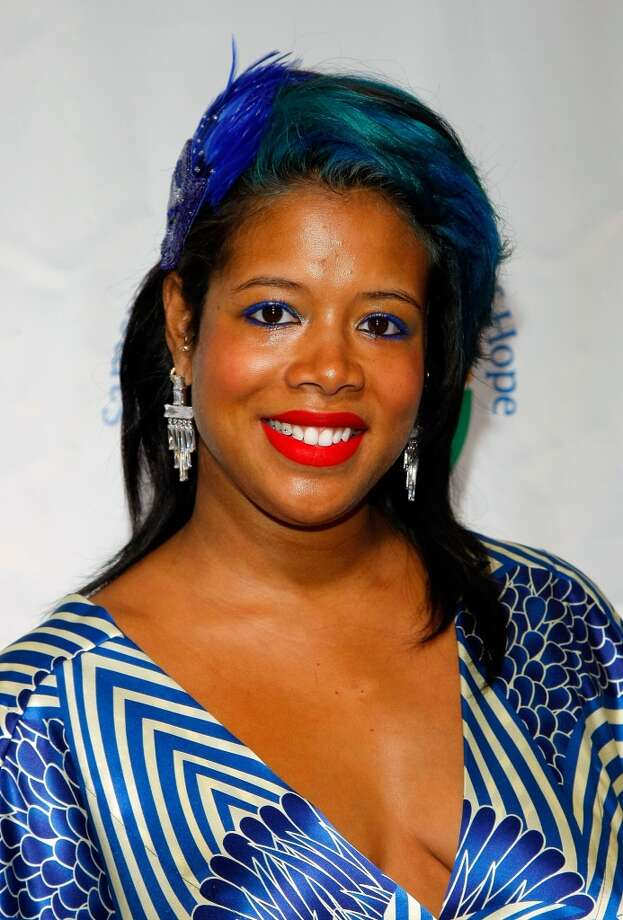 Singer Kelis adds color to her mullet in 2009.