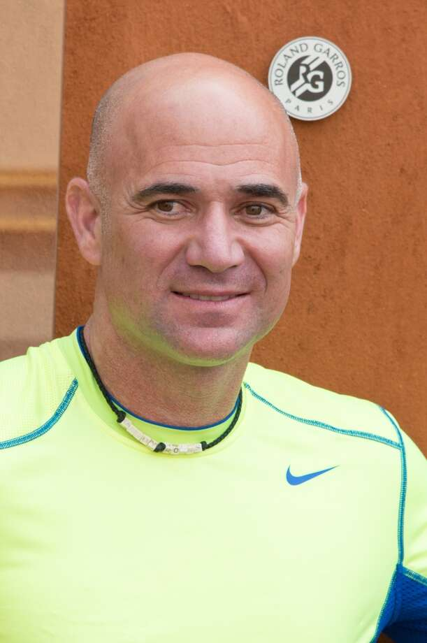 Agassi now flaunts his baldness at tennis tournaments, with no need for outrageous wigs.