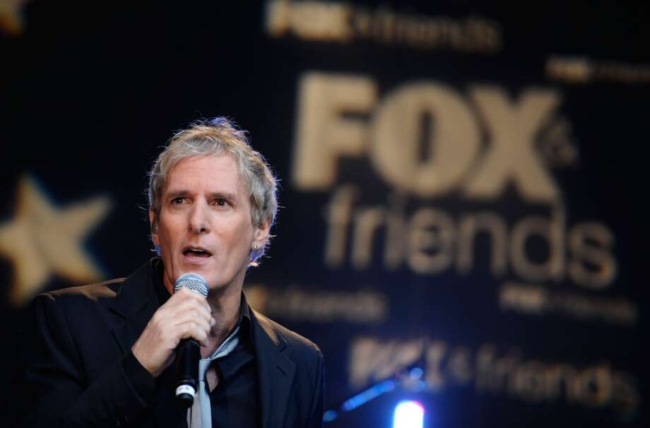 We much prefer Michael Bolton's shorter hair, seen in 2013.