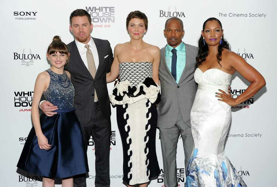 "Cast members, from left, Joey King, Channing Tatum, Maggie Gyllenhaal, Jamie Foxx and Garcelle Beauvais attend the ""White House Down"" premiere at the Ziegfeld Theatre on Tuesday, June 25, 2013 in New York. (Photo by Evan Agostini/Invision/AP) ORG XMIT: NYEA109 Photo: Evan Agostini, AP / Invision"