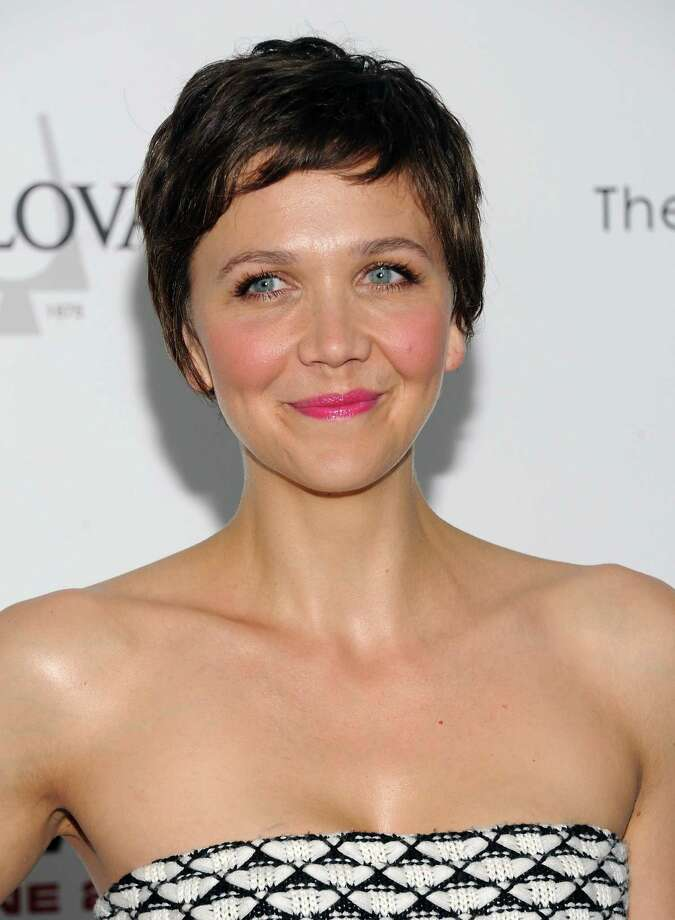 "Actress Maggie Gyllenhaal attends the ""White House Down"" premiere at the Ziegfeld Theatre on Tuesday, June 25, 2013 in New York. (Photo by Evan Agostini/Invision/AP) ORG XMIT: NYEA107 Photo: Evan Agostini, AP / Invision"