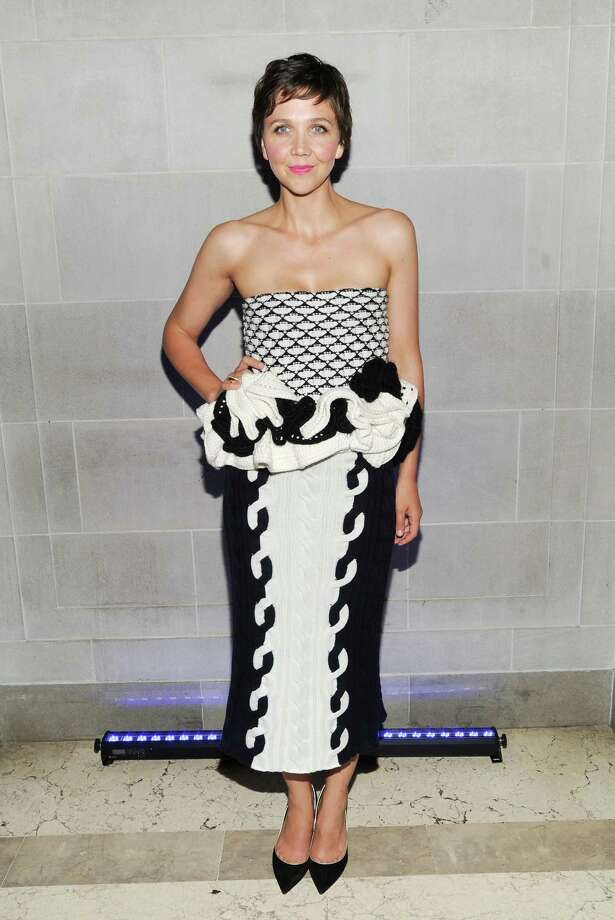 """Actress Maggie Gyllenhaal attends the """"White House Down"""" premiere party at The Frick Collection on Tuesday, June 25, 2013 in New York. (Photo by Evan Agostini/Invision/AP) ORG XMIT: NYEA202 Photo: Evan Agostini, AP / Invision"""