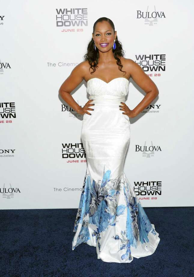 "Actress Garcelle Beauvais attends the ""White House Down"" premiere at the Ziegfeld Theatre on Tuesday, June 25, 2013 in New York. (Photo by Evan Agostini/Invision/AP) ORG XMIT: NYEA102 Photo: Evan Agostini, AP / Invision"