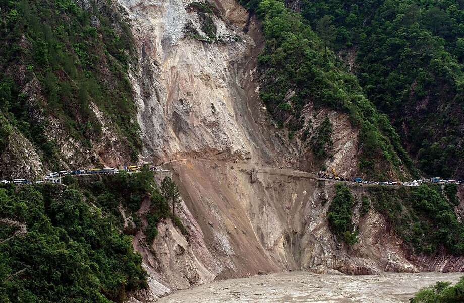It will be a long timebefore anyone travels from Rudraprayag to Srinagar, India, again on this road. Loosened by heavy rains, a large section of earth slid into the raging river below, taking a section of roadway with it. Photo: Manan Vatsyayana, AFP/Getty Images